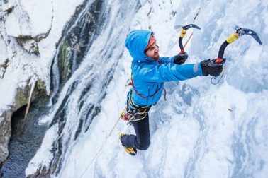 Brave climber facing an extreme ice terrain